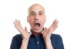 Łysy mężczyzna z szokującym wyrazem twarzy Zdjęcie Royalty Free