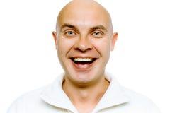 Łysy uśmiechnięty błękitnooki mężczyzna studio odosobniony Obraz Royalty Free
