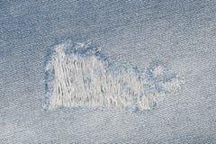 łza na niebieskich dżinsach dla wzoru i tła Fotografia Royalty Free