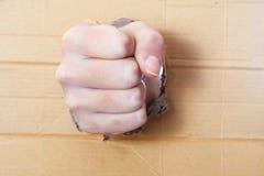 Ściśnięta ręka w pięść poncza desce Zdjęcia Stock