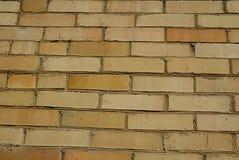 Ściana robić żółta cegła, sposobny porcja jako tło Zdjęcia Stock