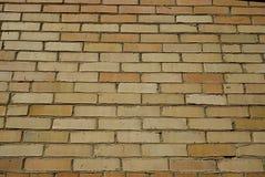 Ściana robić żółta cegła, sposobny porcja jako tło Fotografia Stock