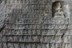 Ściana rzeźbiąca w kamieniu miniaturowy Buddhas Zdjęcia Royalty Free