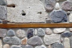 Ściana skały i kamienie w cemencie. Fotografia Royalty Free