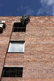 Ściana z cegieł dom z okno i grilles Obrazy Royalty Free