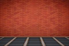 Ściana z cegieł z IR grzejną podłoga Zdjęcia Stock