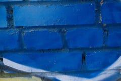 Ściana z cegieł Ściana z cegieł malujący w błękicie obrazy royalty free