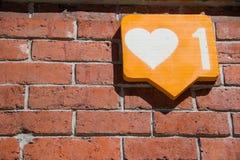 Ściana z cegieł z podobną ikoną zdjęcie stock