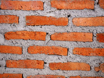 Ściana z cegieł z cementowym tekstury tłem Fotografia Royalty Free