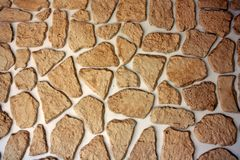 Ściana zakrywająca z kawałkami naturalny kamień i nieregularny kształt obrazy royalty free
