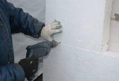 Ścienna izolacja Budowniczego musztrowania ściana dla instalować kotwicy trzymać sztywno izolaci piany deskę zdjęcia royalty free