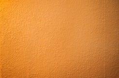Ścienna powierzchnia z słoistą pomarańczową teksturą zdjęcie royalty free