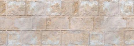 Ścienna struktura - stara gipsująca imitacja kamienie obrazy stock