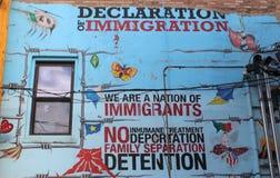 Ścienna sztuka Oczernia Imigracyjną reformę zdjęcie stock