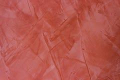 Ściennej tekstury farby czerwony sztukateryjny tło Obrazy Royalty Free