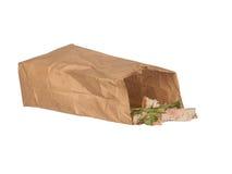 Ściska nadmiar w brown papierowej torbie odizolowywającej na bielu zdjęcie stock