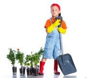 Śliczna chłopiec ogrodniczka zdjęcia royalty free