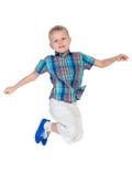 Śliczna chłopiec skacze Zdjęcia Stock