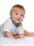 Śliczna chłopiec w łóżku fotografia stock