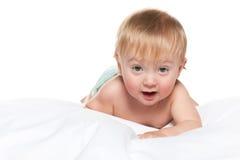 Śliczna chłopiec w łóżku obraz royalty free