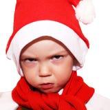 Śliczna chłopiec w Święty Mikołaj kapeluszu zdjęcie royalty free