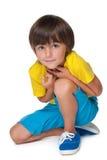 Śliczna chłopiec w żółtej koszula zdjęcia stock