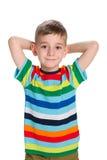 Śliczna chłopiec w pasiastej koszula fotografia stock