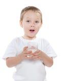 Śliczna chłopiec z szkłem mleko Zdjęcie Stock