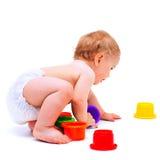 Śliczna dziecięca chłopiec z zabawkami Zdjęcia Stock