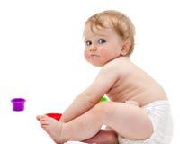 Śliczna dziecięca chłopiec z zabawkami Fotografia Royalty Free