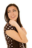 Śliczna dziewczyna jest ubranym polki kropki suknię przyglądającą z powrotem Obrazy Stock
