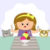 Śliczna dziewczyna z żółtym łękiem siedzi przy stołem i je lody Kot i pies oglądamy royalty ilustracja