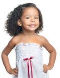 Śliczna mała afro amerykańska dziewczyna odizolowywająca na bielu Fotografia Stock