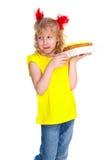 Śliczna mała blondynka liże jej wargi, odizolowywać na białym tle Fotografia Royalty Free