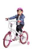 Śliczna mała dziewczynka na rowerze Fotografia Stock