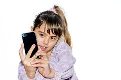 Śliczna mała dziewczynka robi selfie Zdjęcie Stock