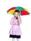 Śliczna mała dziewczynka z kolorowym parasolem Zdjęcia Stock