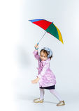 Śliczna mała dziewczynka z kolorowym parasolem Obraz Stock