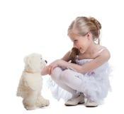 Śliczna mała dziewczynka z miękkiej części zabawką Obrazy Royalty Free