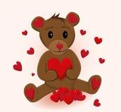 Śliczna małego niedźwiedzia mienia czerwień słucha Fotografia Stock