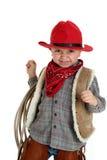 Ślicznego berbecia kowbojski uśmiechnięty mienie arkana jest ubranym czerwonego kapelusz Obrazy Stock
