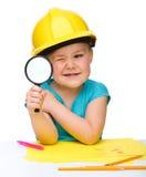 ślicznej dziewczyny mały przyglądający magnifier Obrazy Stock