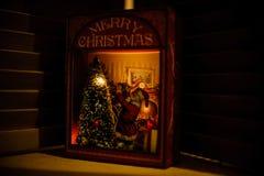 Śliczny Bożenarodzeniowej nocy światło w postaci pudełka z Santa Obraz Royalty Free