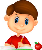 Śliczny chłopiec kreskówki writing na książce Zdjęcie Royalty Free