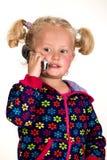 Śliczny dziecka mienia telefon komórkowy, odizolowywający Fotografia Royalty Free