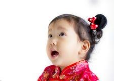 Śliczny dziecko jest ubranym czerwonego Chińskiego kostium Obraz Royalty Free