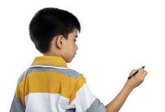 Śliczny Indiański chłopiec Writing Obraz Royalty Free