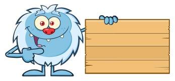 Śliczny Mały yeti kreskówki maskotki charakter Wskazuje Drewniany puste miejsce znak Obraz Stock