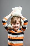 Śliczny Preschooler ma zabawę z jego faszerującą zabawką Obraz Royalty Free