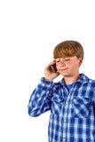Śliczny przystojny młody chłopiec mówienie Obraz Royalty Free